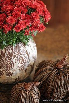 We adore this festive pumpkin flower pot from @Julie Forrest Middle Aisle!