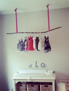 Baby clothes can be so pretty, so we love the idea of displaying them (plus, they'll be easy to grab!).