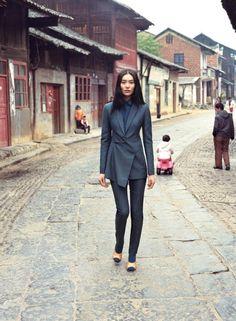 Liu Wen, wearing Akris jacket and pants