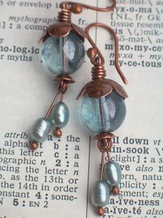 Earrings Everyday: Cool Water Blossoms- wow, another great use for those tiny bead caps!