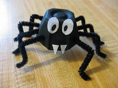 Adorable egg carton spider craft.