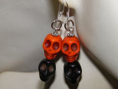 Hand Crafted Day of the Dead Earrings with Black and Orange Turquoise Sugar Skulls, and Sterling Silver French Style Earring Hooks. by MelancholyMind, on Etsy $9.99