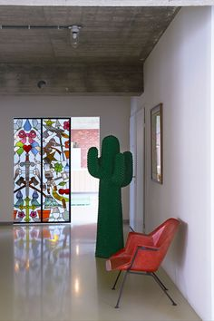 Hall. Stained Glass Sliding Doors, Studio Job. Cactus, Gufram. Chair, Wim Rietveld. Poster, Keith Haring. Photo by Dennis Brandsma.