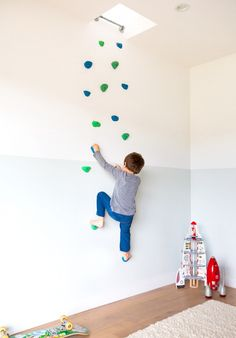 "One of the more unique elements in the home is the custom climbing wall in their son's room. ""It leads to the upstairs living room,"" Cleo tells us about the unusual inclusion...."