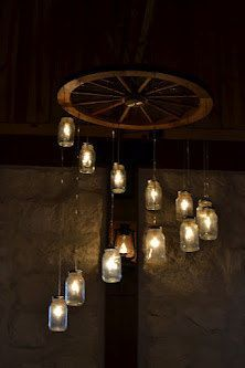 ba69f4022d5e96de2787f0881cb684fe wagon wheel chandelier mason jar chandelier diy steampunk chandelier from a wagon wheel that's legit tips Connecting a Wire Chandelier at nearapp.co