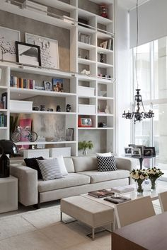 Book shelves from floor to ceiling, consider adding a sliding ladder or antique step stool for top shelf items. Great storage! Add cabinet doors or baskets for hiding storage.