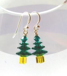Christmas Tree Earrings These sparkly Swarovski christmas trees also make pretty little pendants – just make one up and add it to a jump ring and slip it onto a chain…They also cost only £3.68 per pair to make up! Ingredients 2 x Sterling Silver Earwires Round with Ball 2 x 2 Inch Sterling Silver Headpins 2 …