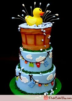 Rubber Ducky baby shower cake - I made this for my friend who had twins, so I put 2 ducks on the top  didnt do the splashes that are on wires ~ Amber