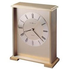 Howard Miller Exton Table Top Clock. h1Howard Miller Exton Table Top Clock_h1The Howard Miller Exton Table Top Clock is finished in brushed and polished brass, this metal carriage-style clock boasts classic good looks. The brushed brass tone dial is accented.. . See More Table Clocks at http://www.ourgreatshop.com/Table-Clocks-C1125.aspx