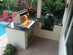 Custom Outdoor kitchen with Alfresco Grill and Big Green Egg