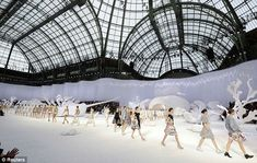 Models present creations by German designer Karl Lagerfeld for his Spring/Summer 2012 women's ready-to-wear collection