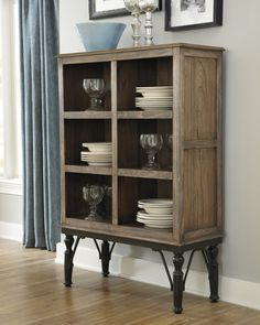 "The Tripton server with its six 16"" deep nooks for storage, oak finish and industrial legs will proove to be a unique piece within your dining room."