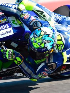 Valentino Rossi at work. Trying to escape the sharks chasing him.
