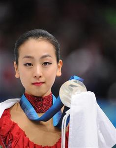 Asada Mao with her Olympic medal