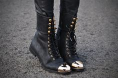 Metallic-toed boots.