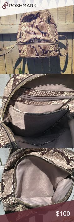 Michael Kors mini backpack Faux snakeskin, but genuine leather! This Super chic Michael Kors backpack has so many places for toting all your essentials! Used once or twice, and shows no signs of wear due to me storing it in its dust bag, which is included with this purchase! Michael Kors Bags Mini Bags