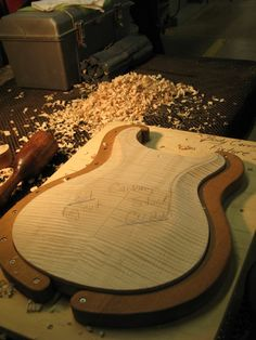 PRS electric guitar body, just after being roughly carved, before hand work begins