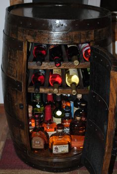whiskey barrel Liquor cabinet w lazy susan & built in wine rack with removable door.