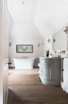 by Neptune Home - that bath tub is amazing. A few candles and this bathroom would be perfect!