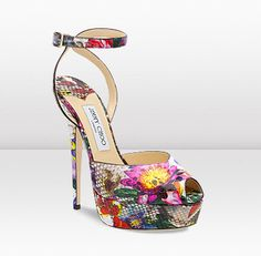 "Featured in the Spring Summer Ad Campaign, these exotic multi coloured printed python sandals accentuate the romantic theme of the collection. This shoe is complete with a 'peekaboo' cut out peep toe and kissing ankle strap. Heel height measures 145mm/5.7""."