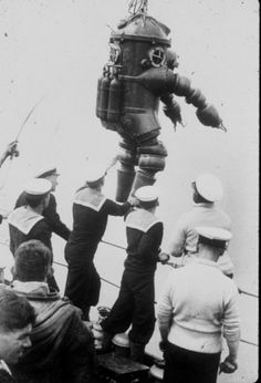 """1935:    Preparing to explore the wreck of the Lusitania. 'J. Peress' dive suit, Tritonia, explored the Lusitania wreck in 1935. Jim Jarrett was Peress's chief diver and made this dive to 312 feet. This suit was a precursor to the """"Jim"""" suit, named for Jim Jarrett.'"""