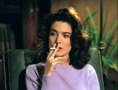 by / nineties anxiety: Lara Flynn Boyle as Donna Hayward in 'Twin Peaks', April 1991 location: . Twin Peaks 1990, Laura Palmer, Between Two Worlds, Smoking Ladies, David Lynch, Film Stills, The Magicians, Twins, Wavy Hair