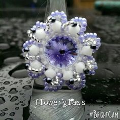 Check out this item in my Etsy shop https://www.etsy.com/uk/listing/238352822/swarovski-rivoli-and-bicone-flower-ring