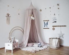 Stunning girl room   Numero74 featured products: Powder canopy, gold falling star garland, small star lantern.