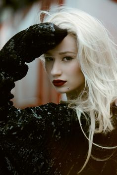 White blonde hair and bold lips.