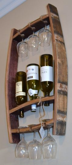 SALE SALE SALE Originally priced @$119.99 This stunning piece was crafted from recycled Napa Valley wine barrels. It will hold 3 bottles of your favorite wine along with six wine glasses. The oak wine staves have been sanded and treated to accommodate for indoor or outdoor use. 31x20x4