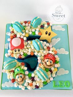When you turn 5 and love Super Mario then this is a cake for you. Original design on biscuit by Cupcake Avenue. A number 5 sculpted English Toffee cake with handmade edible faces!