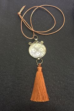 A personal favorite from my Etsy shop https://www.etsy.com/listing/454117804/tassel-necklace-long-leather-with