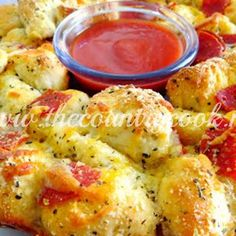 Pull-apart Pizza bread. This looks good enough to throw a party just so I can make it.