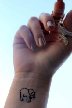 "74 Of The Tiniest, Most Tasteful Tattoos Ever: I would put underneath the elephant, ""Forgive, but never forget."""