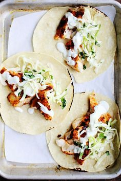 Spicy Fish Tacos with Cabbage Slaw + Lime Crema. The cabbage slaw and lime crema makes it so delicious! Slaw Recipes, Fish Recipes, Seafood Recipes, Mexican Food Recipes, Cooking Recipes, Healthy Recipes, Tilapia Recipes, Cooking Gadgets, Snacks