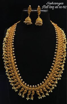 Are you looking for bridal jewellery on rent online? Get south Indian bridal jewellery sets for rent at TBG Bridal Store and look like a queen on your wedding day. South Indian Bridal Jewellery, Bridal Stores, Queen, On Your Wedding Day, Pearl Necklace, Pearls, Diamond, Gold, Beautiful