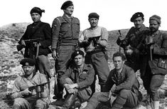 Twenty-year-old Major Patrick Leigh-Fermor (seated center) and Captain Stanley Moss (seated right) pose with several Greek partisans who participated in the kidnapping of German General Heinrich Kreipe on the island of Crete. Battle Of Crete, South East Europe, Beloved Book, Guerrilla, World War Ii, New Image, Ww2, The Book, Greece