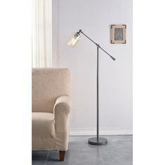 null When your ensemble is in need of a little illumination, you might be tempted to install a hardwired luminary or spring for an end table and a lamp to go with it. The easiest solution? A floor lamp! Take this one for example: Offering a touch of industrial design to your abode, it showcases clean-lined frame made from metal in a polished finish. Up top, its cylindrical shade made from glass boasts a warm coloring and accommodates one 60 W E26 light bulb (LED equivalent included). Base Finish X 23, Industrial Style Floor Lamp, Industrial Design, Farmhouse Floor Lamps, Floor Lamp Base, Tall Ceilings, Futuristic Furniture, Drum Shade, Lamp Bases