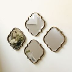 Living room - Mix with other small art or wall pieces.... Crest Mirror | Ballard Designs