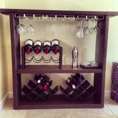 DIY wine bar  2x12 lumber cut to size  painted Attached glass racks