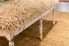 This bench with a shag upholstered top is unexpected and adds texture to your room. By Surya.