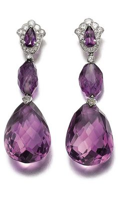 A PAIR OF ART DECO AMETHYST AND DIAMOND EAR PENDANTS, BY CARTIER Each designed as a faceted drop-shaped amethyst, connected by a collet-set diamond and tumbled faceted amethyst, to the pear-shaped amethyst and diamond surmount, set in platinum, signed Cartier, Paris, circa 1920.