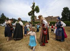 Children dance around a smaller version of the Majstang, or Maypole, during the 2015 Skandia Midsommarfest at St. Edward State Park in Kenmore on Sunday. The pole symbolizes fertility during the traditional Swedish celebration of the summer solstice. (Sy Bean/The Seattle Times)