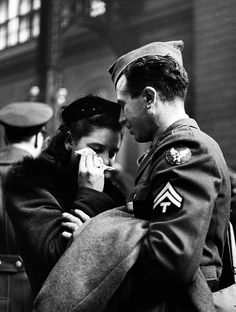 A soldier comforts his sweetheart while saying goodbye at Pennsylvania Station by Alfred Eisenstaedt, 1944. S)
