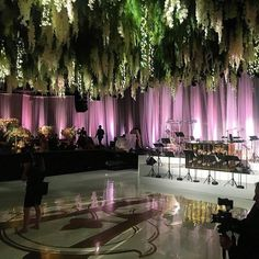 #regram : @spencerbarnesla  And even the dance floor was magical with suspended florals greenery and purple lighting.  @sharonarshadnia #sharashwedding (Venue: @beverlyhilton / Planner: @akatecarlsonevent / Florals: @butterflyfloral / Band: @liventgroup / Rentals: @palacepartyrental / Photography: @jessicaclaire / Lighting: @thelightersidela)