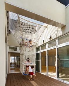 OB-kindergarten | a rope made climbing tunnel allows children to climb up onto the roof