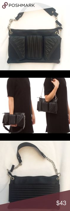 SALE GX by Gwen Stefani GX by Gwen Stefani for Shoe Dazzle. A front panel with three exterior pockets on this style allows you to slip your hand through for cool clutch option, or use the chain-link shoulder straps for hands-free carry. NWOT GX by Gwen Stefani Bags