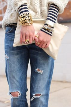 Love the juxtaposition. Stripes, weathered jeans, classic fisherman sweater, gold jewelry... heaven.