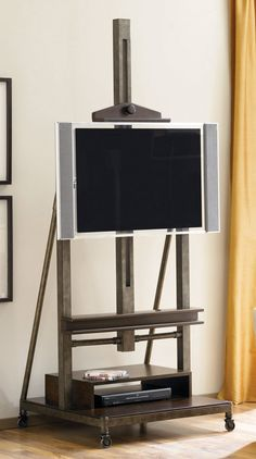 Add a little creativity and modern style to your living room setting with the Hammary Furniture Structure TV easel. The Hammary Furniture Structure TV easel stand carries a metal frame and an easel to place your flat screen te Belfort Furniture, Tv Furniture, Business Furniture, Coaster Furniture, Large Furniture, Modular Furniture, Apartment Furniture, Furniture Projects, Easel Tv Stand