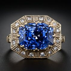 8.62 Carat Electric Blue Octagonal-Cut Sapphire and Diamonds in a beautiful 18k Yellow Gold Ring